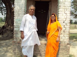 Me & My Wife in front of Ramshackle Temple of my Family Deity , Kul Devi