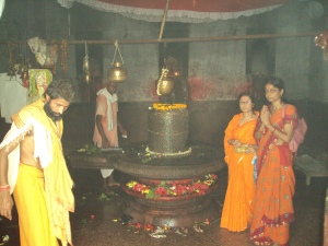 The Lingam in Sanctum Sanctorum , My Wife & Sister paying Obeisance