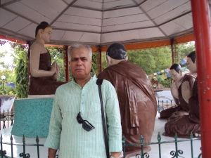 At Statue of Buddha Giving First Sermon to His Desciples